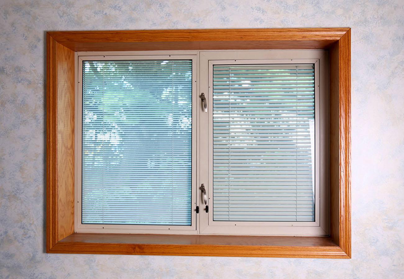 waci-between-glass-blinds-partially-open